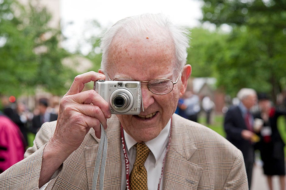 Richard Griffin '51 gives the photographer a taste of his own medicine. Jon Chase/Harvard Staff Photographer
