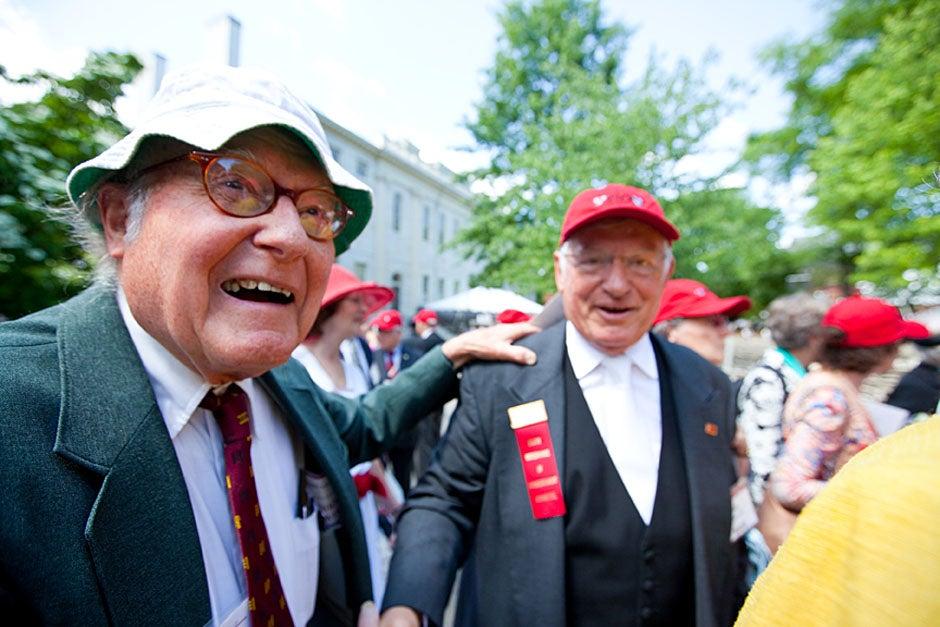 "Graham Taylor '49 (left) greets his fellow ""jock club"" friend, Bill Markus '60 during the Alumni Parade. Rose Lincoln/Harvard Staff Photographer"