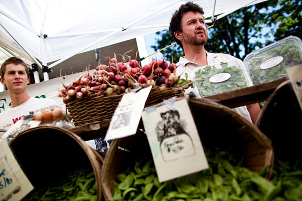 The Farmers' Market at Harvard opened for its fifth year on the lawn between the Science Center and Memorial Hall. Calder Alexander (left) and Andrew Pollock, owner of Silverbrook Farms, had produce aplenty.