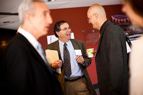 At an all-day symposium on aging, Harvard Medical School Dean Jeffrey Flier greets the arriving participants and speakers.