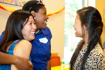 The Crimson Summer Academy held its first alumni barbecue, which gave current scholars a chance Wednesday to meet program graduates who are now in college, including alumni scholars (from left) Chi Tran of Northeastern University, Sabrina Antoine of Smith College, and Madelyn Voong of Emmanuel College.