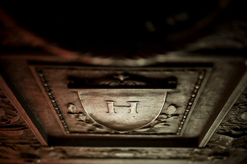 """""""H"""" is for handsome. In the right light, this embossed Harvard shield glistens inside Robinson Hall. Stephanie Mitchell/Harvard Staff Photographer"""