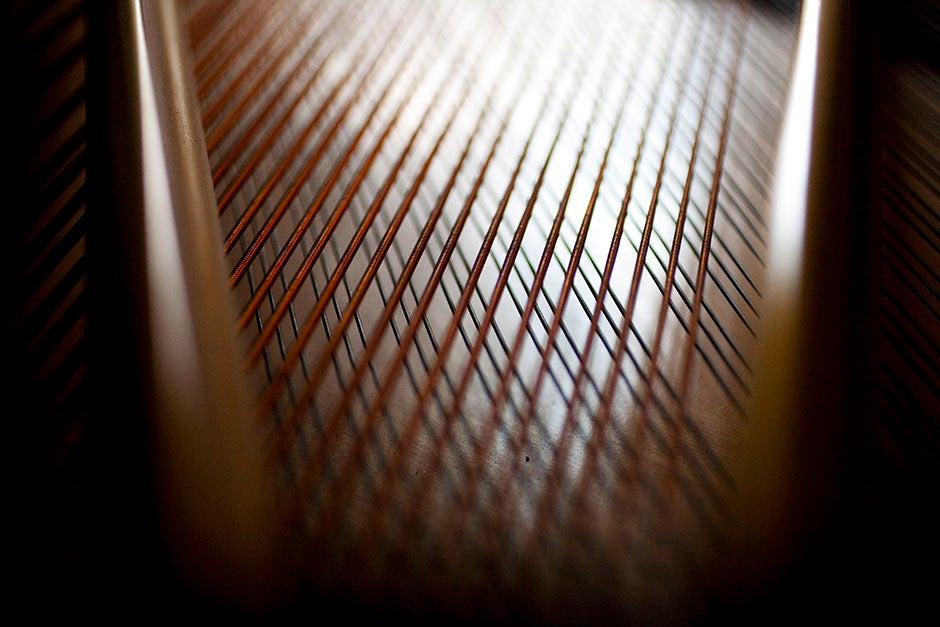 A network of strings intersects in a River House piano. Stephanie Mitchell/Harvard Staff Photographer