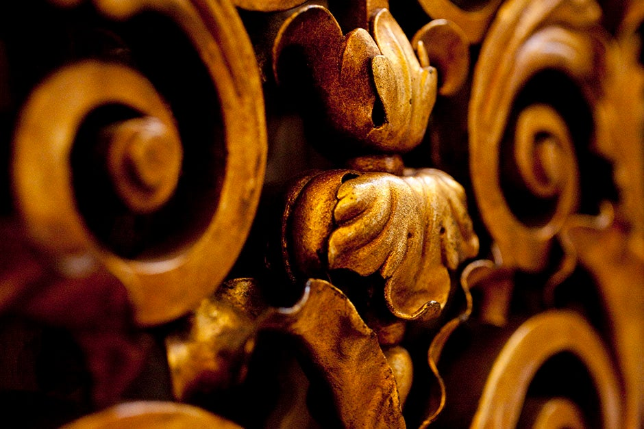 What seems like rich bronze is actually wood: These distinctive embellishments blaze inside Widener Library. Stephanie Mitchell/Harvard Staff Photographer