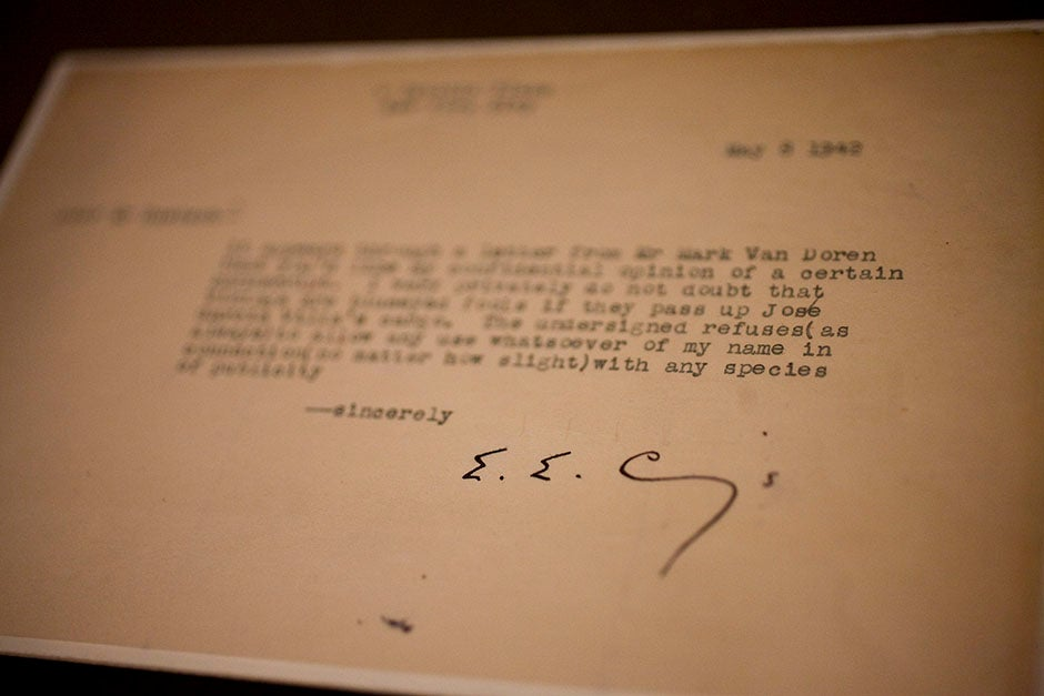 The signature of e.e. cummings punctuates a page in Houghton Library. Stephanie Mitchell/Harvard Staff Photographer
