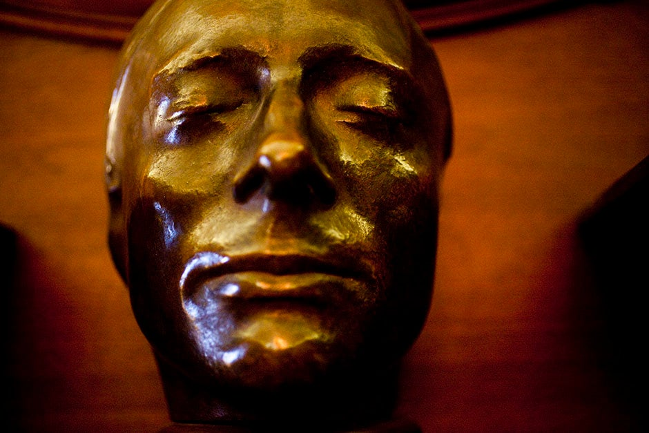 The death mask of John Keats rests above the mantel in the Keats Room of Houghton Library. Stephanie Mitchell/Harvard Staff Photographer