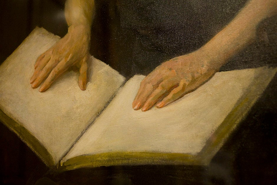 The plaintive hands of Helen Keller hover above these painted pages in the Barker Center's Thompson Room. Stephanie Mitchell/Harvard Staff Photographer