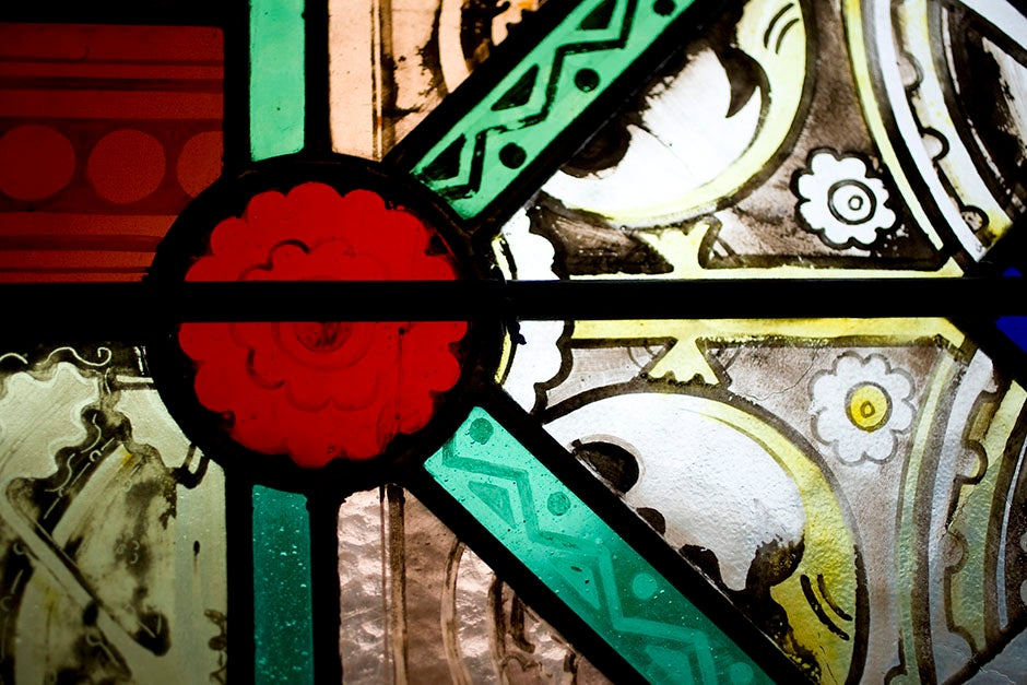 The transept of Memorial Hall boasts elegant stained glass windows. Stephanie Mitchell/Harvard Staff Photographer