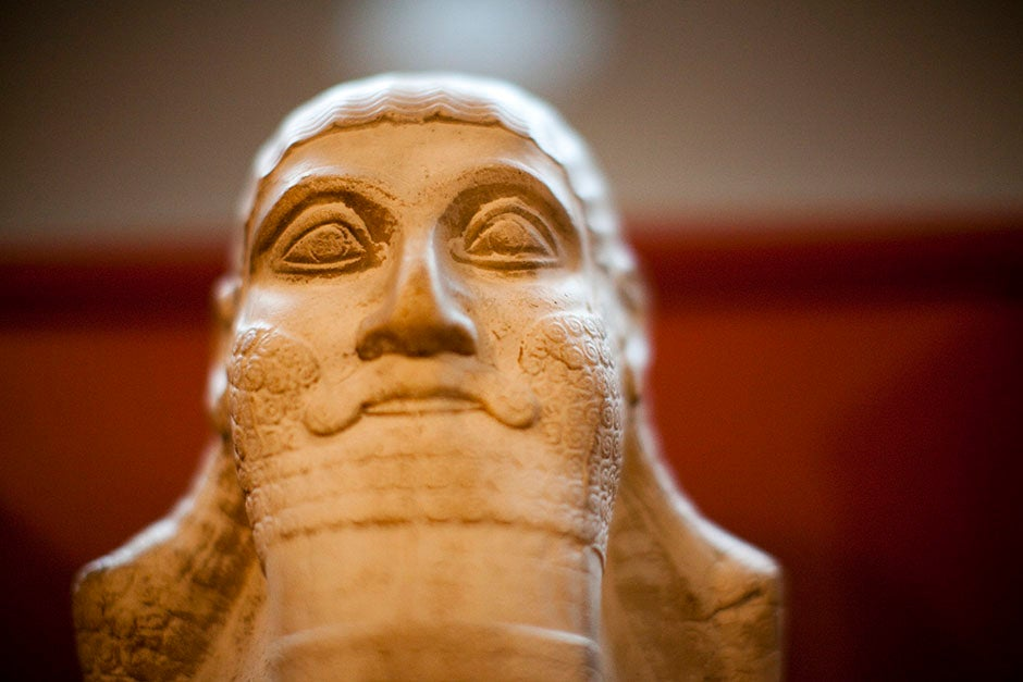A haunting and stately carved face collects majestic light inside the Semitic Museum. Stephanie Mitchell/Harvard Staff Photographer