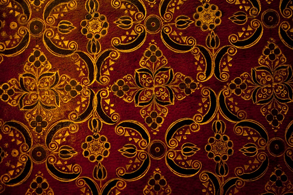 A volume intricately decorated in crimson and gold is on display in Houghton Library. Stephanie Mitchell/Harvard Staff Photographer