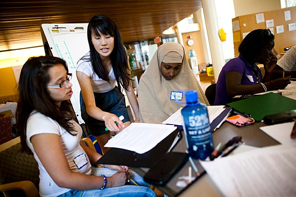 Jocelyn Ramirez of John D. O'Bryant School (from left), mentor Christine Hu '13, Maryan Sharif of Boston Latin Academy, and Ymahri Brown of Codman Academy Charter Public School work on a problem set. The Crimson Summer Academy (CSA), Harvard's intensive residential and academic enrichment program, brings talented low-income high school students from Cambridge and Boston to Harvard over three consecutive summers to help prepare them for selective four-year colleges.