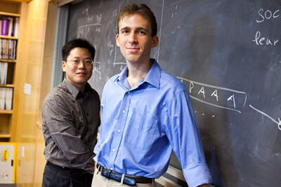 Researchers Feng Fu (left) and Daniel Rosenbloom found that even small changes in the perceived costs or risks of vaccination  can affect public immunization efforts.