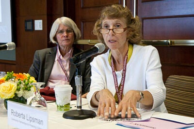 Roberta Lipsman (right), of Community Partnerships for Protecting Children in Portland, said her organization's goal is to support children and families so the children stay out of state care. Julie Wilson (left), director of the Malcolm Wiener Center for Social Policy, opened the Aug. 5 forum at the Harvard Kennedy School.