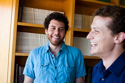 Joshua Greene (left) and Amitai Shenhav have found that people  make major moral decisions using the same brain circuits used for more mundane choices, like spending money or choosing food.