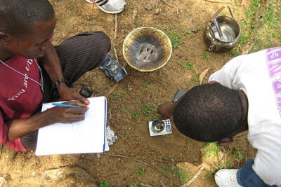 Students at the University of Liberia weigh rubber tree wood chips prior to burning them on a small metal stove in a calorimetry experiment to determine whether they might be an adequate source of energy for the west African nation. The experiment was part of a science workshop presented by Harvard chemist Adam Cohen, M.D.-Ph.D. student Benjamin Rapoport, and MIT graduate student Elizabeth Wood.