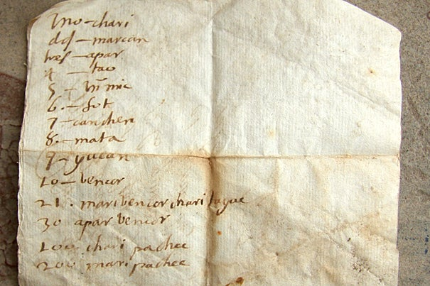 The back side of an early 17th century letter shows translations for numbers from Spanish to a lost language.