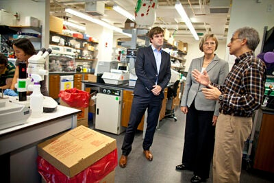 Harvard University President Drew Faust (center) visits with Doug Melton (right), co-director of the Harvard Stem Cell Institute, and Kevin Eggan (left), associate professor of stem cell and regenerative biology.