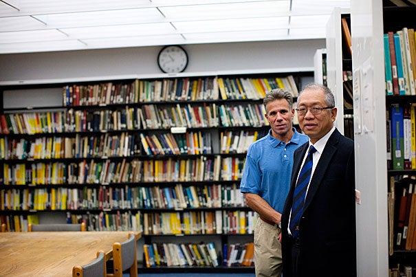 "Graustein Professor of Mathematics Shing-Tung Yau (far right) teamed up with Steve Nadis (in blue), a research assistant in mathematics, to tell the story of the discovery of Calabi-Yau manifolds in ""The Shape of Inner Space: String Theory and the Geometry of the Universe's Hidden Dimensions."" Yau jokes in the book's preface that the phrase ""Calabi-Yau"" has been used so often in recent years that he almost feels that ""Calabi"" is his first name, which he says he'd be proud to have."