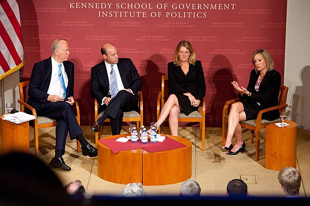 Ari Fleischer (second from left),  Camille Johnston, and Dee Dee Myers reprised their roles as media go-betweens during a panel discussion at the John F. Kennedy Jr. Forum. The three took questions from the audience and from David Gergen (far left), the moderator and director of the Center for Public Leadership.