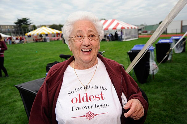 Rita DiGesse, an Allston resident who has lived in the same house for 81 years, is a familiar face at Allston-Brighton Family Football Day, a Harvard tradition more than 20 years old.
