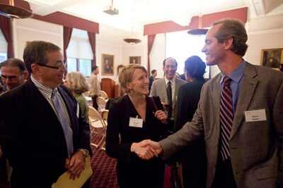 Researchers at Harvard Medical School and the Harvard Catalyst have recently selected 12 pioneering ideas for attacking type 1 diabetes, ideas selected through a crowdsourcing experiment called the Challenge. Robynn Sturm (center), assistant deputy chief technology officer at the Office of Science and Technology Policy, speaks with Kevin Dolan (right), HMS's senior human resources consultant, and HMS Dean Jeffrey Flier.