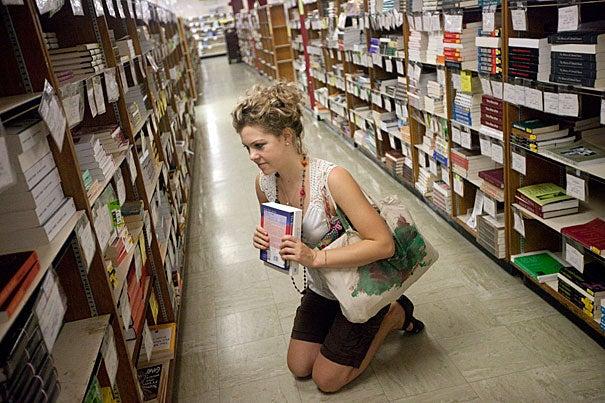Tess Hellgren '11 shops for course books inside the Harvard Coop.