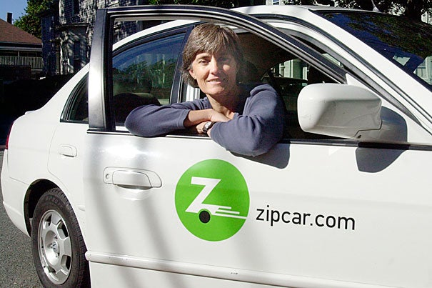 Robin Chase, Zipcar co-founder and CEO, poses by her bright idea in 2004, when she was a Loeb fellow at the Graduate School of Design. Harvard offers several transportation options for students, faculty, and staff, including Zipcar and ridesharing programs.