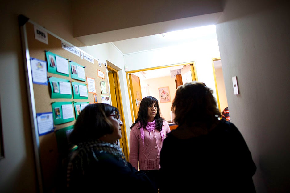 At EPES headquarters, staffers meet and discuss the country's most pressing health care issues such as domestic violence, HIV protection and awareness, tobacco control, early breast cancer detection, and environmental health. Stephanie Mitchell/Harvard Staff Photographer