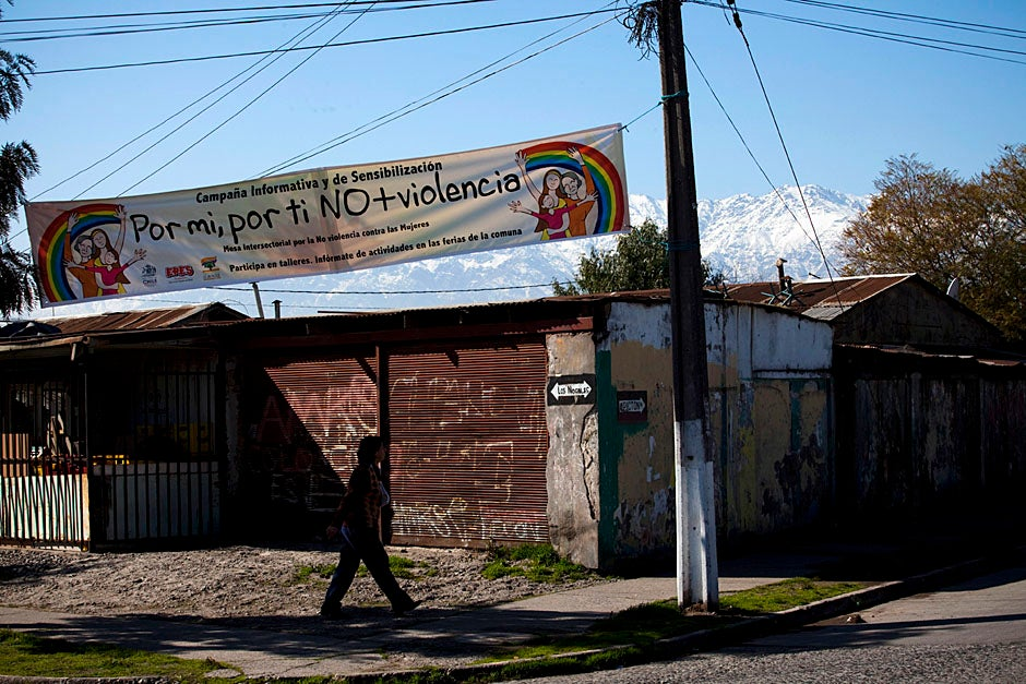 The Andes hang in the background of an anti-violence banner suspended between street posts. Stephanie Mitchell/Harvard Staff Photographer