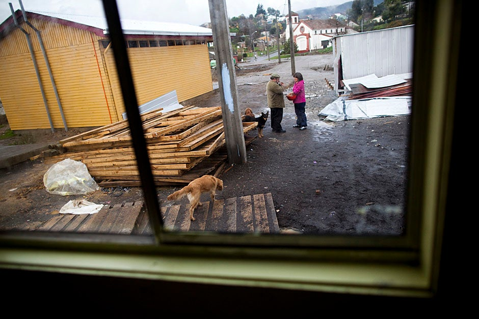 Campamento Villa Bosquemar, a housing settlement in Penco, demonstrates the conditions in which families have lived under since the earthquake and tsunami. Lopez (left) speaks with Nuvia Villegas, one of the residents of the campamento. Stephanie Mitchell/Harvard Staff Photographer