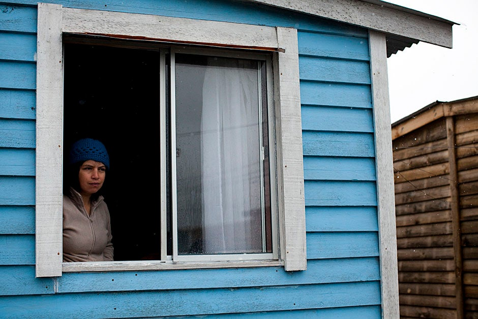 With cold winter temperatures and damp conditions, families struggle to keep warm inside their temporary houses. Stephanie Mitchell/Harvard Staff Photographer