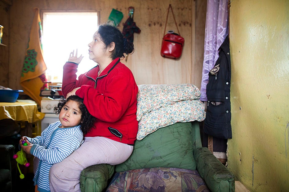 Two-year-old Brittany Garrido Chacamo and her mother, Paulima Chacamo Guatardo, who is five months pregnant, are pictured in their house in Campamento Santa Clara. Stephanie Mitchell/Harvard Staff Photographer