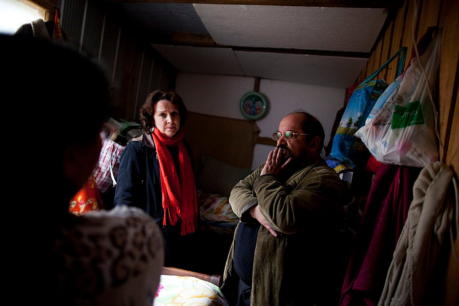 Anderson (from left) and Lopez listen to Barrales share stories and concerns regarding the health of her family and the cold winter conditions faced by the community in Villa Bosquemar. Stephanie Mitchell/Harvard Staff Photographer