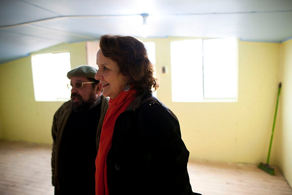 Lopez (from left) and Anderson speak inside the Villa Bosquemar Community Center. The EPES donated the furnishing, insulation, and painting of the center. Stephanie Mitchell/Harvard Staff Photographer