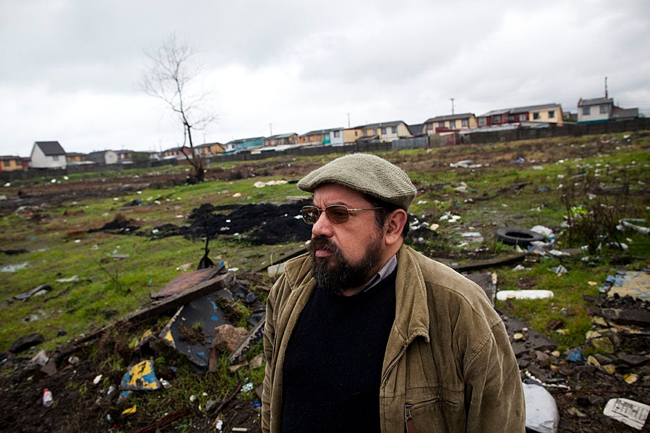 "Lopez wades through an area in Santa Clara affected by the tsunami. ""This catastrophe overturned many of our assumptions and also brought us, as EPES, back to our roots,"" observed Lopez. ""In southern Chile, we carry earthquakes in our blood. So it wasn't the buckling of the earth, the power of the sea, that most surprised us. It was the absence of the state, the void, and the chaos."" Stephanie Mitchell/Harvard Staff Photographer"