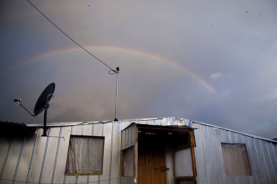 A rainbow appears above the winterized homes in Villa Bosquemar. Stephanie Mitchell/Harvard Staff Photographer