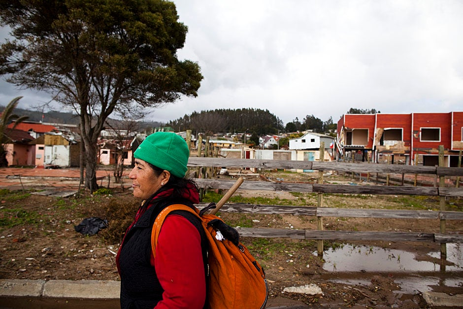 A woman walking along the shoreline in Dichato speaks of the devastating effects of the earthquake and tsunami. Dichato is a town along the coast of Chile, part of the municipality of Tomé in a northern part of Greater Concepción. At the 2002 census it had 3,057 residents. Stephanie Mitchell/Harvard Staff Photographer