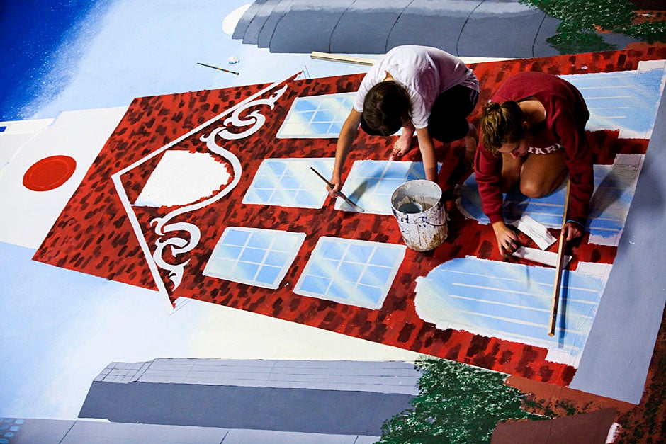 Ginny Fahs '14 (left) and Megan McDonnell '14 paint some Harvard against the Boston skyline. Stephanie Mitchell/Harvard Staff Photographer