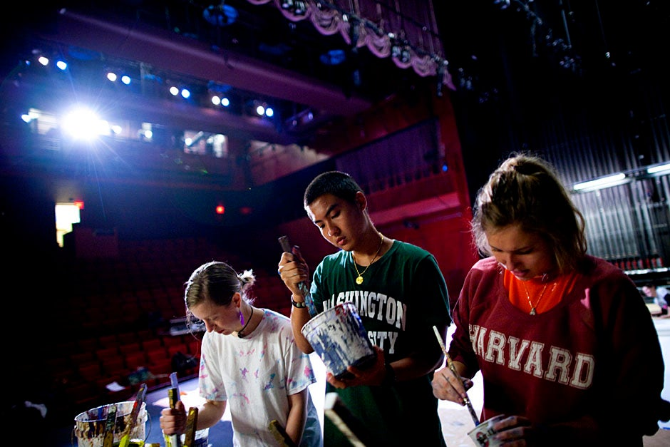 More elbow grease! Samantha Berstler '14 (from left), Alec Yeh '14, and Megan McDonnell '14 stir the paint. Stephanie Mitchell/Harvard Staff Photographer