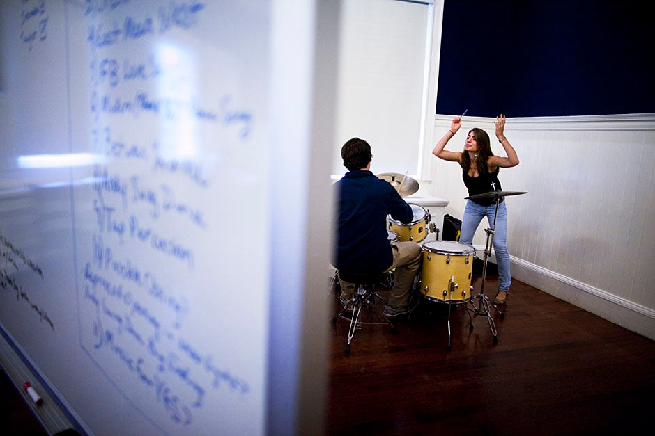 Behind the dry erase board, Aviva Hakanoglu '14 (right) conjures magic in a drum rehearsal for the pageant. Stephanie Mitchell/Harvard Staff Photographer