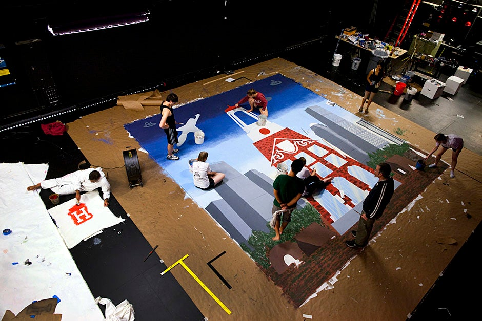 Freshmen work to complete the pageant backdrop. Stephanie Mitchell/Harvard Staff Photographer
