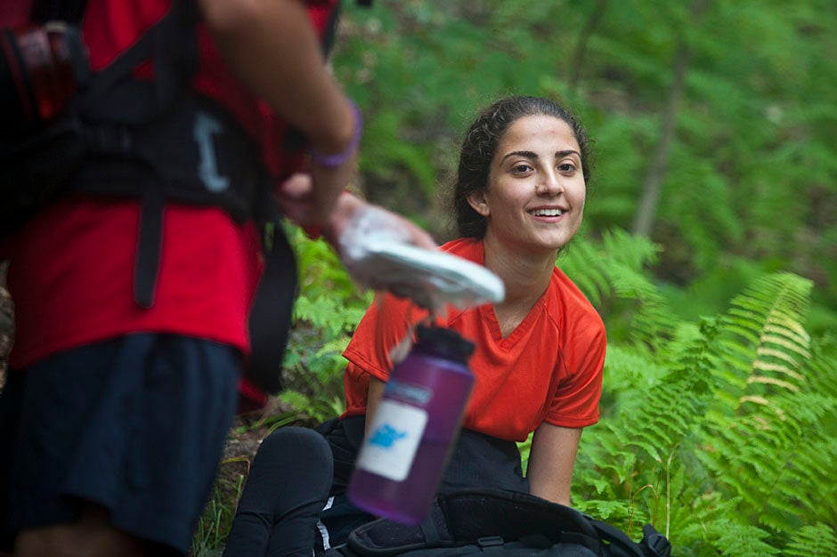 Class of 2014 member Katya Johns takes a breather during a water break along the trail. Justin Ide/Harvard Staff Photographer