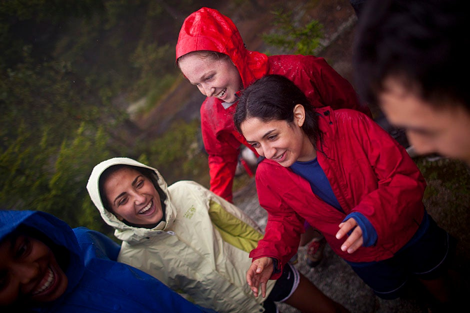 "Trip 43 celebrates a wet but well-fought victory in a game of ""Zoo"" against Trip 42 on the summit.  Justin Ide/Harvard Staff Photographer"