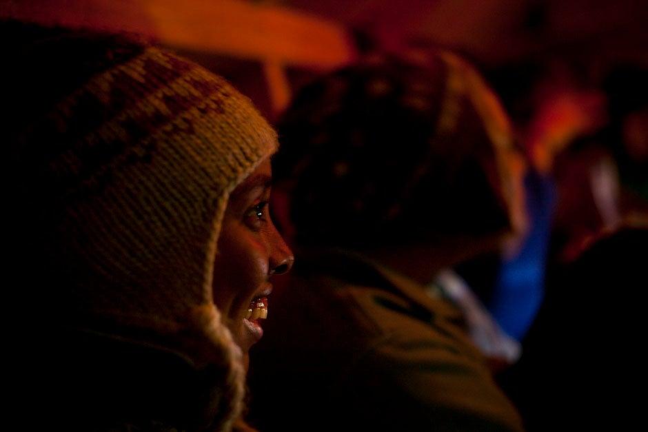 Freshman Simone Polanen laughs during dinner time inside the shelter.  Justin Ide/Harvard Staff Photographer