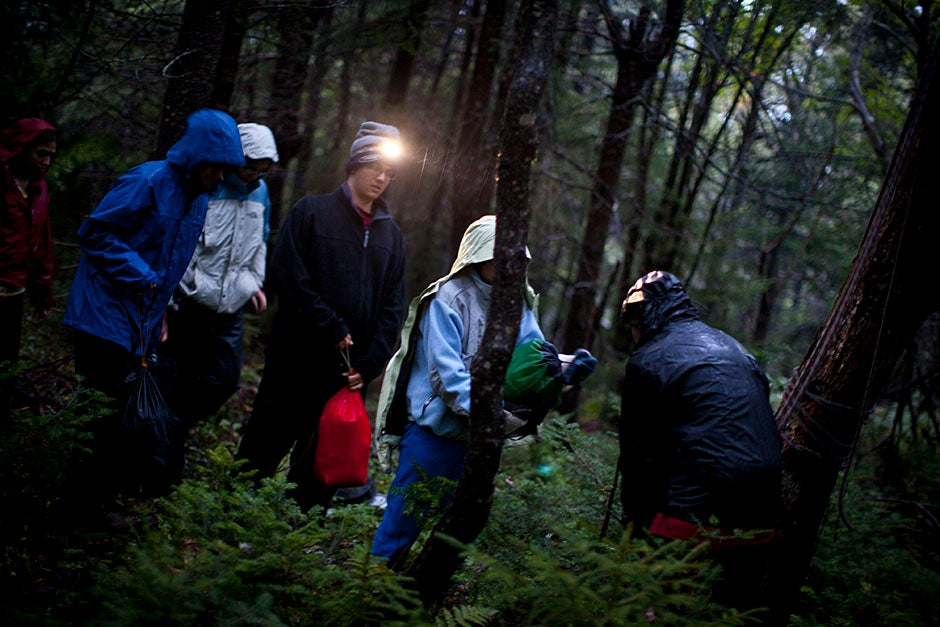 "After cleaning up dinner, FOP'ers put food and other belongings into a ""bear bag,"" which is then hoisted into a tree for the night, away from camp.  Justin Ide/Harvard Staff Photographer"