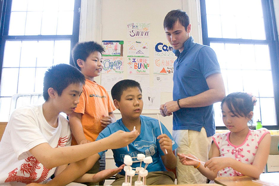Boston students build marshmallow towers during Phillips Brooks House Association's (PBHA) Chinatown Adventure summer program. Kris Snibbe/Harvard Staff Photographer