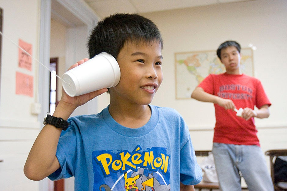 Boston students make paper cup phones during PBHA's annual Science Olympiad. Kris Snibbe/Harvard Staff Photographer