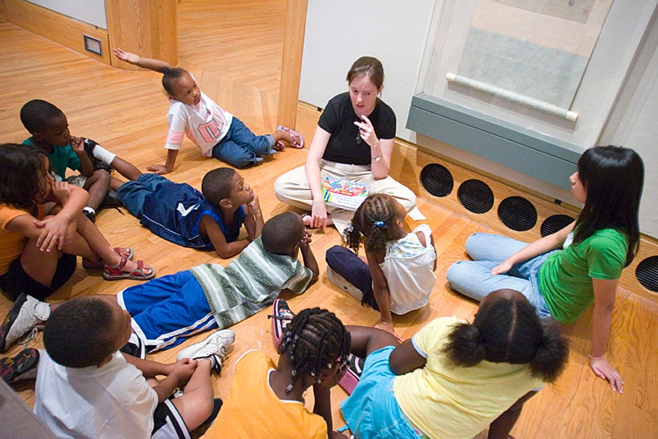 Children gather for a reading during a field trip to the Arthur M. Sackler Museum. Stephanie Mitchell/Harvard Staff Photographer