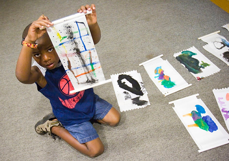 A Boston student shows off his work during a visit to the Sackler Museum. Stephanie Mitchell/Harvard Staff Photographer