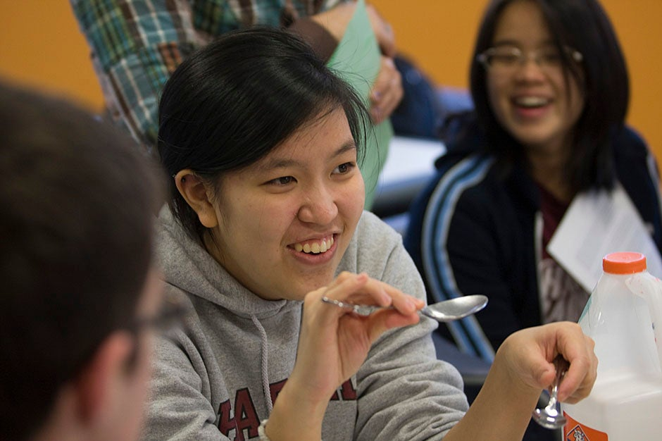 Cynthia Wu '13 (left) and Erica Lin '10 do a science demonstration for students from the Gardner Pilot Academy. Kris Snibbe/Harvard Staff Photographer